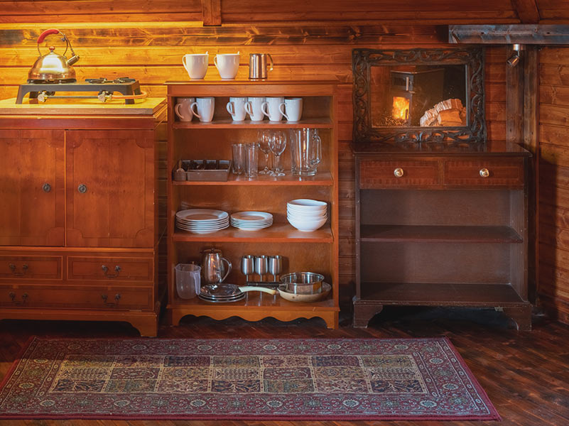 Kitchenette and shelf of crockery and kitchenware