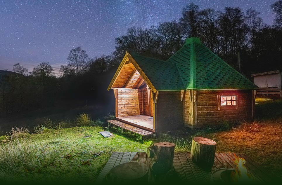 Cabin with glowing lights in the dark of the night